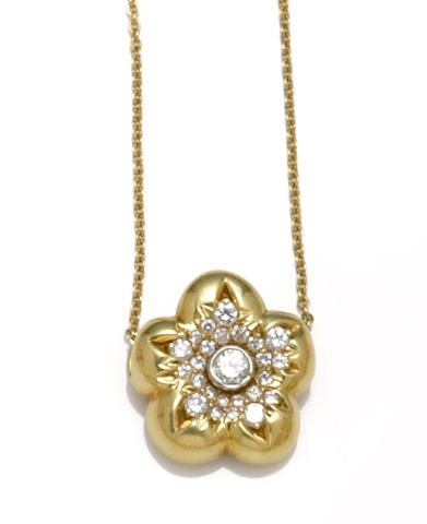 A diamond flower pendant with chain, José Hess