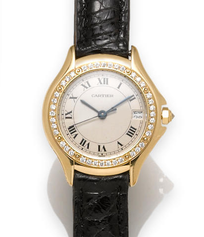 Cartier. A diamond and 18k gold ladies strap wristwatch with date