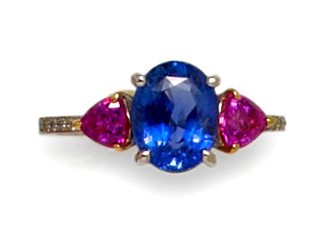 A blue and pink sapphire and diamond ring