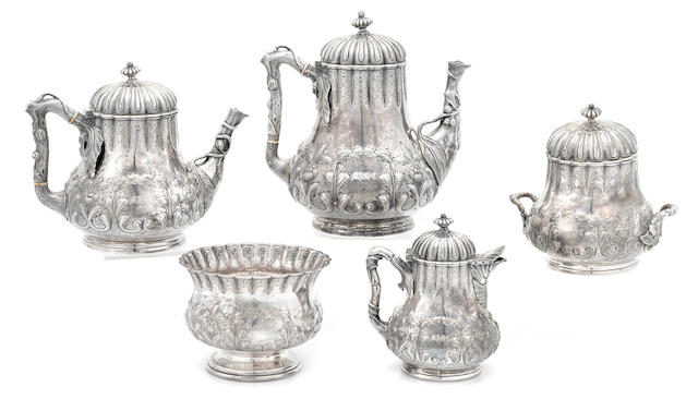 An American coin silver floral-repousse-decorated five piece tea and coffee service by Grosjean & Woodward; retailed by Tiffany & Co., New York, NY, circa 1854 - 1870
