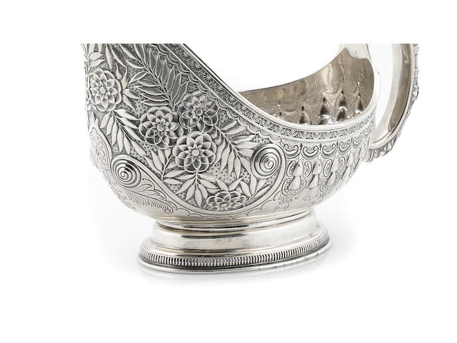An American  sterling silver  floral-repousse-decorated sauce boat by Tiffany & Co., New York, NY  circa 1876