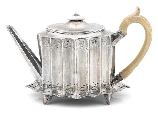 A George III  sterling silver  teapot and stand by Henry Chawner, London, 1788