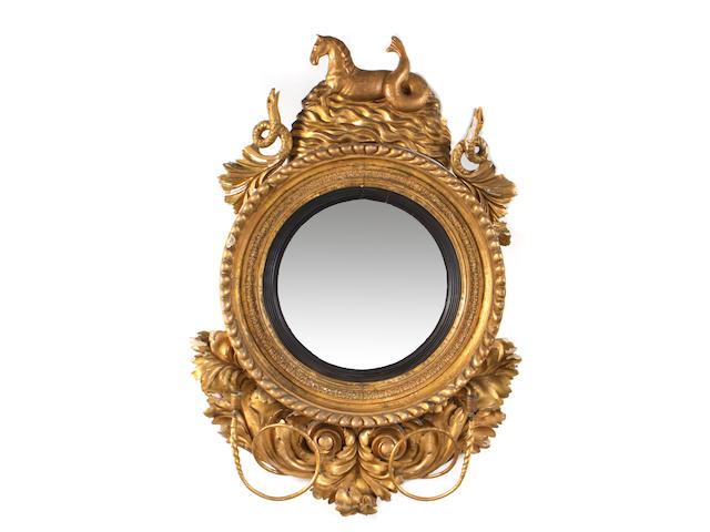 A Regency giltwood convex girandole mirror