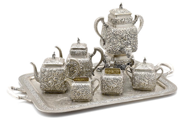An American sterling silver six piece tea and coffee service, with repousse floral decoration, Bailey, Banks & BIddle; together with a silver soldered tray (one floral swag to kettle stand off and retained)