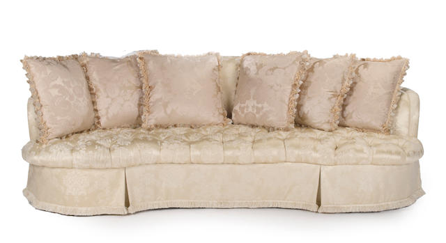 A Contemporary ivory silk brocade upholstered tufted sofa
