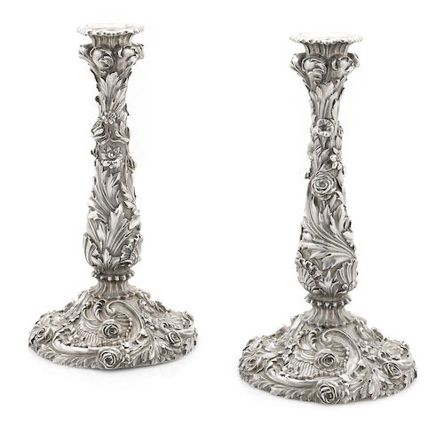 A pair of George IV cast sterling silver floral and foliate candlesticks by Benjamin Smith III, London, 1822