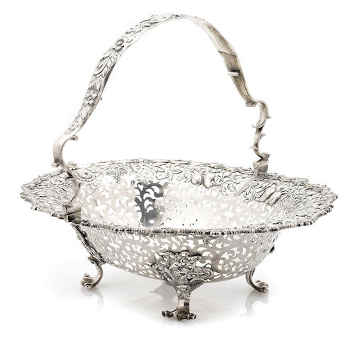 A George IV sterling silver pierced floral and foliate decorated footed basket by Edward Farrell, for Kensington Lewis, London, 1829