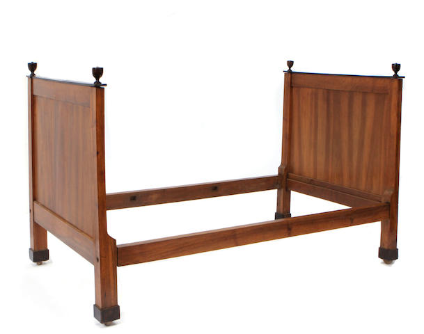A Directoire style walnut and ebonized bed