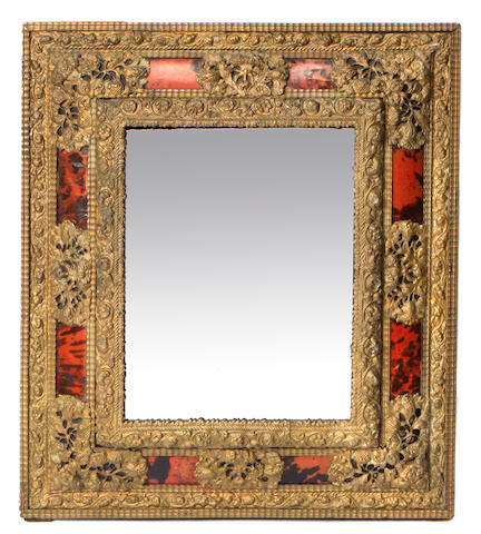 A Dutch Baroque style repoussé brass wall mirror