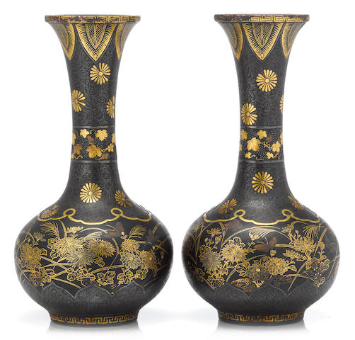 A pair of iron damaslened vases Meiji period