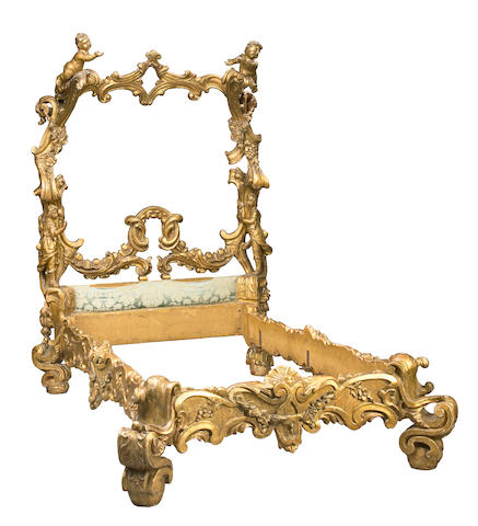 An imposing Venetian Rococo style carved giltwood bed
