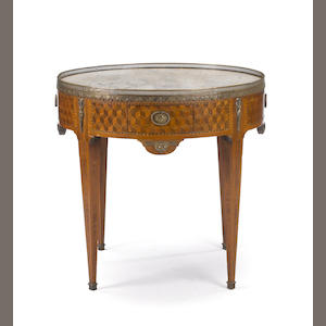 A Louis XVI style gilt bronze mounted parquetry bouillotte table . late 19th century