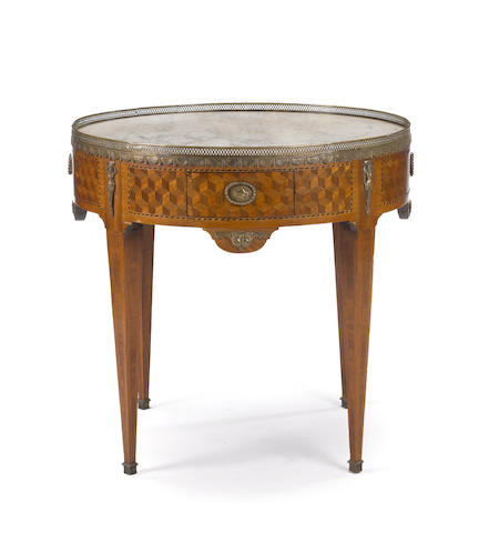 A Louis XVI style gilt bronze mounted parquetry bouillotte table <BR />late 19th century