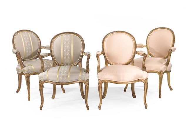 A set of four George III style ?????VET POSSIBLY 18th century giltwood open armchairs <BR />late 19th century