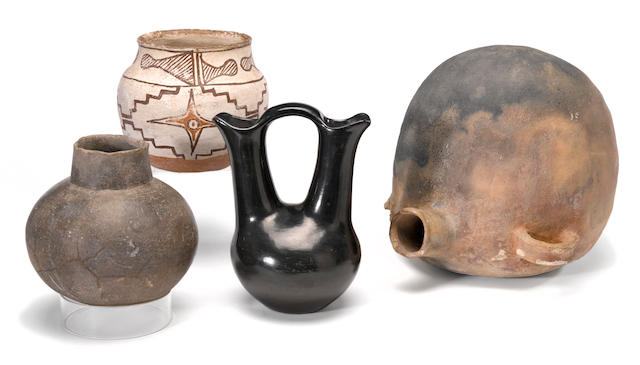 Four Native American pottery vessels