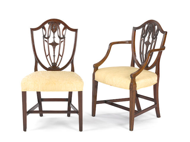 An assembled set of eight George III mahogany shield back chairs, c. 1800