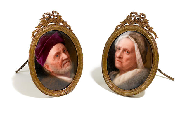 A pair of German porcelain oval plaques in gilt metal frames