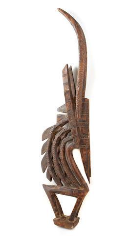 A Bamana chiwarra antelope headdress;a Senufo mask; a New Guinea lime mortar