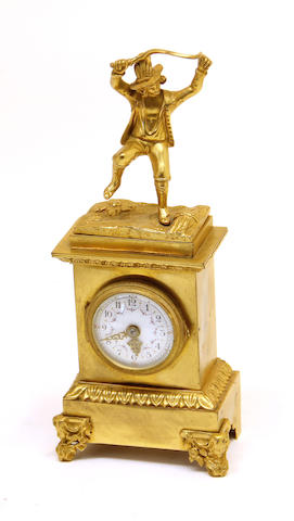 A French gilt bronze figural desk clock 19th century