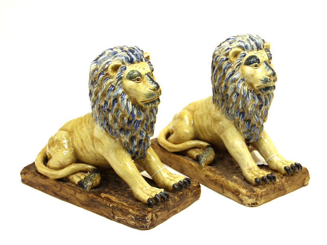 A pair of Continental faience lions 20th century