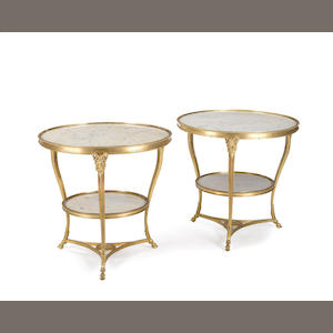 A pair of Louis XVI style gilt bronze and marble guéridons. late 19th century