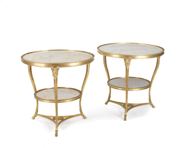 A pair of Louis XVI style gilt bronze and marble guéridons<BR />late 19th century