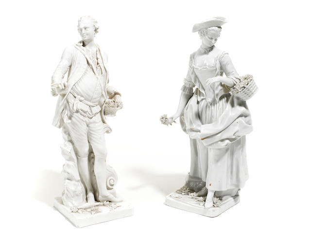 A pair of Continental blanc de chine porcelain figures