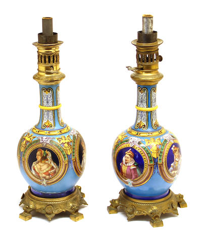 A pair of French gilt bronze mounted ceramic oil lamps late 19th century