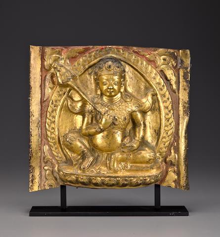 Jambhala Plaque, Tibet, 16th Century, Gilt-copper repousse