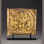 Jambhala Plaque, Tibet, 16th Century, Gilt-copper repousse