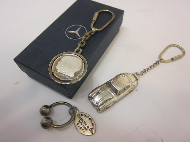 A collection of three fine, sterling silver, Mercedes-Benz key fobs,