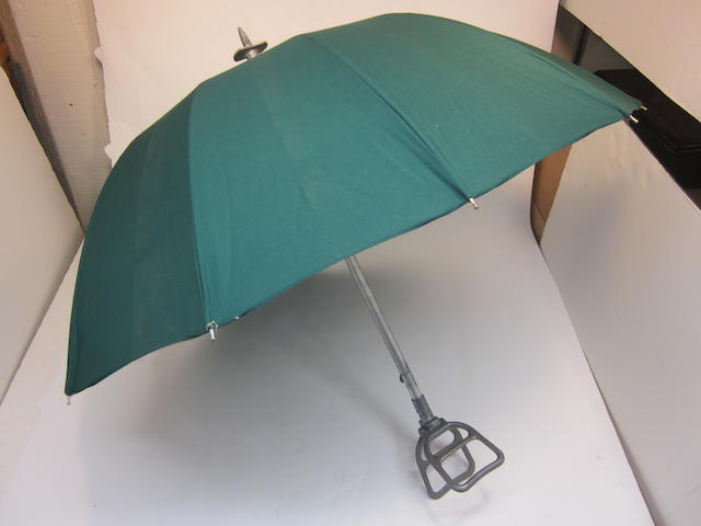 "A vintage Porsche ""shooting stick"" umbrella,"