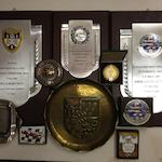 A large grouping of trophies awarded to Leo Levine,