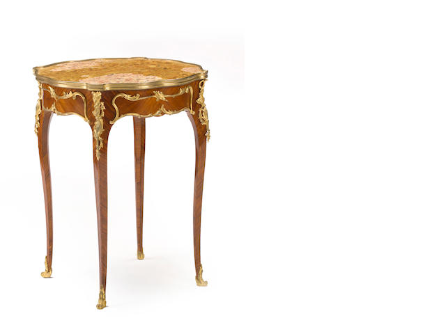 A Louis XV style gilt bronze mounted tulipwood parquetry guéridon <BR />late 19th century
