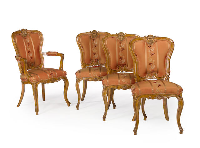 A set of fourteen Italian Rococo style fruitwood upholstered dining chairs <BR />20th century