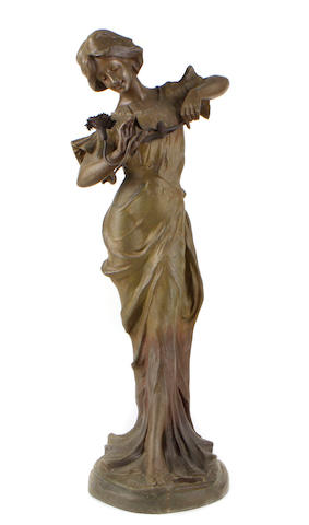 A patinated metal figure of a maiden