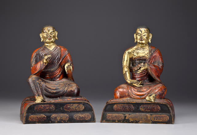 A pair of copper alloy repousse and polychrome arhats Tibeto-Chinese, 17th century