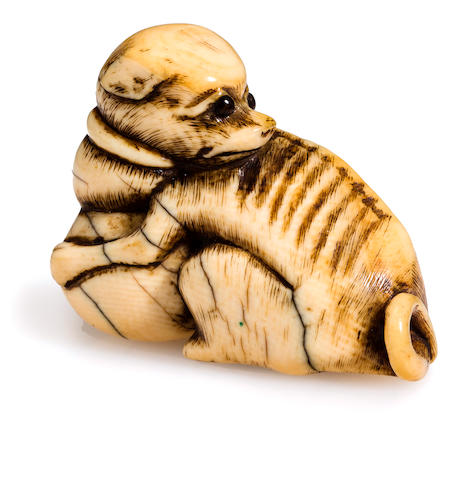 Ivory netsuke of a dog on a ball, 19th century