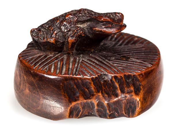 Wood netsuke of frog on millstone, Masanao