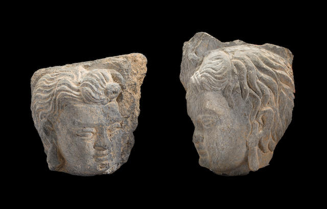 Two grey schist fragments of heads of deities Ancient region of Gandhara, 2nd/3rd century