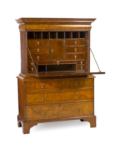 A Queen Anne burled walnut drop front secretary<BR />first quarter 18th century