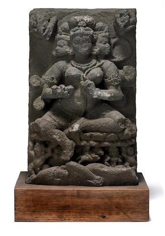 A volcanic stone female bodhisattva Java, 10th-12th century