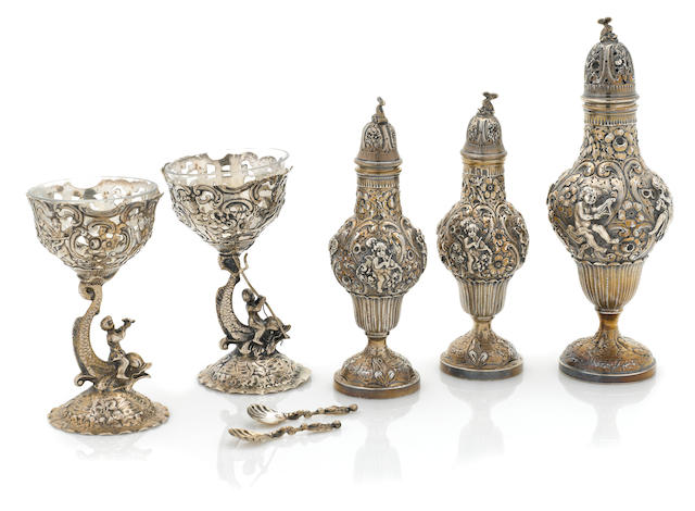 A German silver condiment suite- three casters, two pedestal salts and two spoons