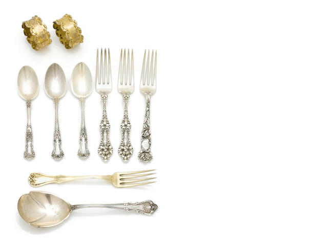 An assortment of sterling and coin silver flatware