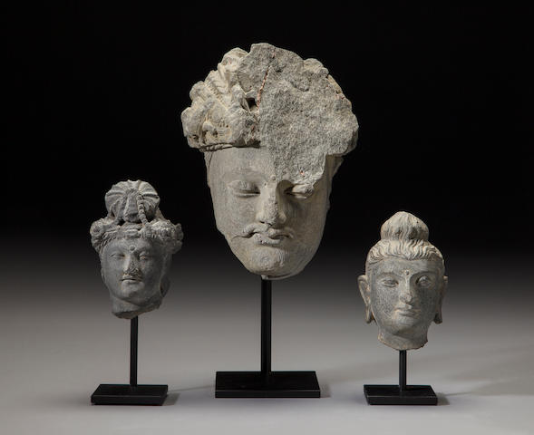 Three grey schist heads of deities Ancient region of Gandhara, 2nd/3rd century