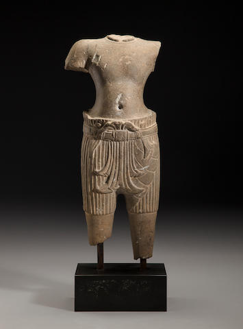 A sandstone torso of a four-armed deity Cambodia, Bakheng style, late 9th/early 10th century