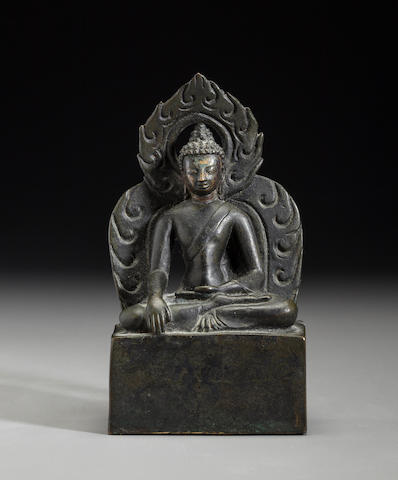 A Copper alloy figure of Shakyamuni Buddha Nepal, 19th century