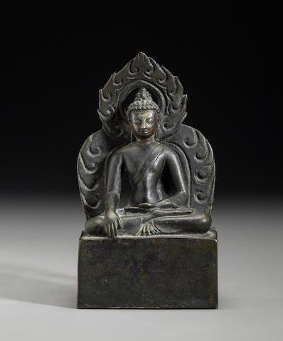A Copper alloy figure of Shakyamuni Buddha Nepal, 19th century