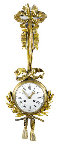 A Louis XVI style gilt bronze cartel clock