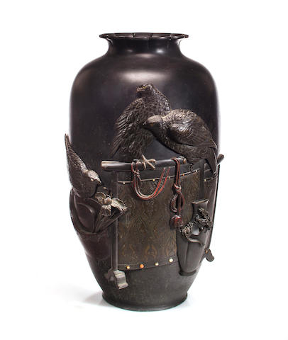 A bronze vase decorated with tethered falcons, sealed